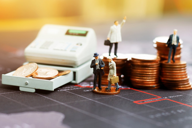 illustrated image of coin stacks and counting machine for the best coin counter reviews and buying guide
